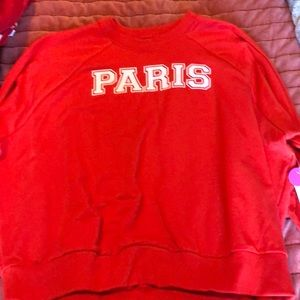 Red sweatshirt that says Paris on it.
